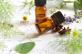Two brown bottles of essential oils