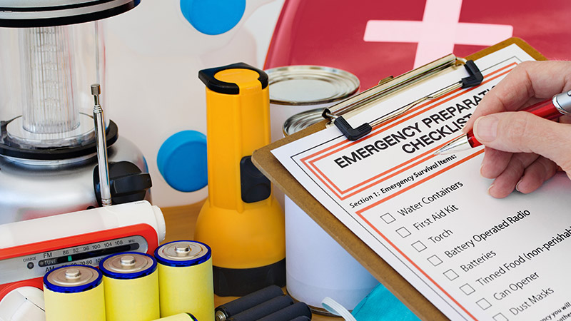 Checklist next to emergency supplies